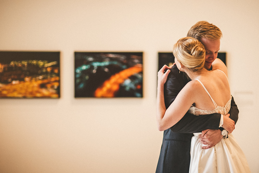 groom hugging during first look