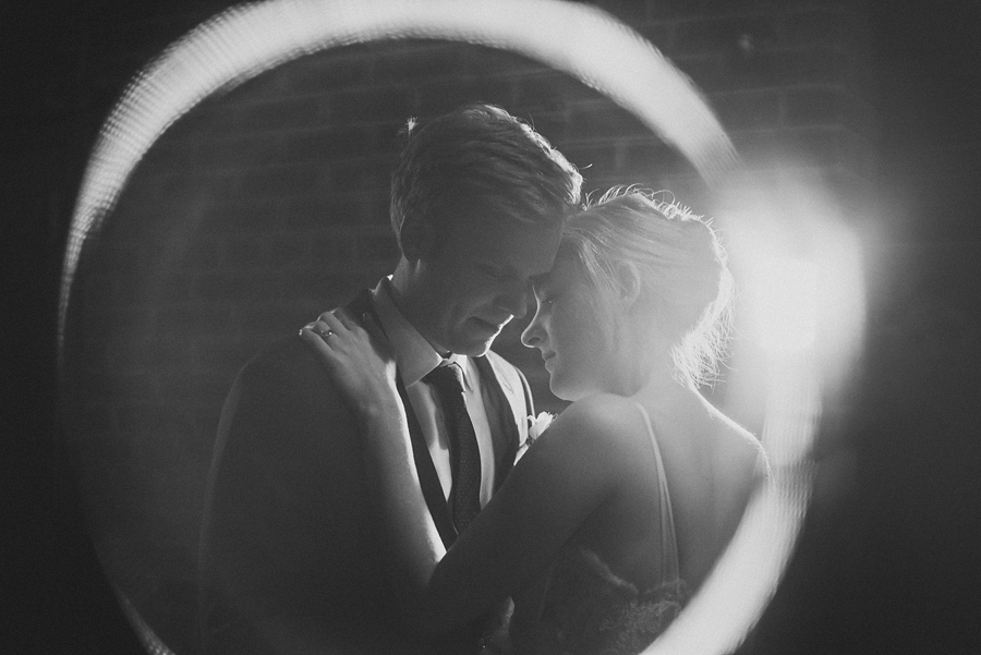 creative portrait of bride and groom at longview gallery on their wedding day