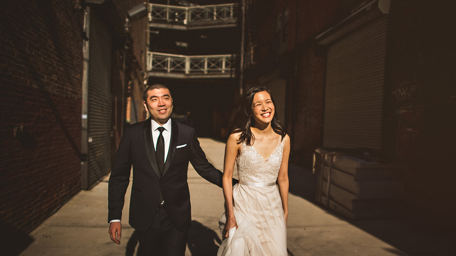 bride and groom laughing and walking together on their wedding day