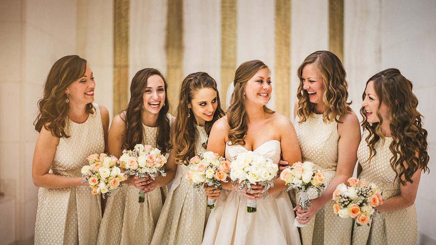 bride and bridesmaids laughing candid