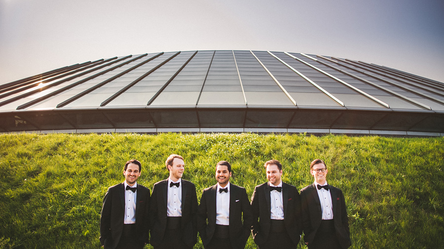 groom laughing with groomsmen in front of adler planetarium
