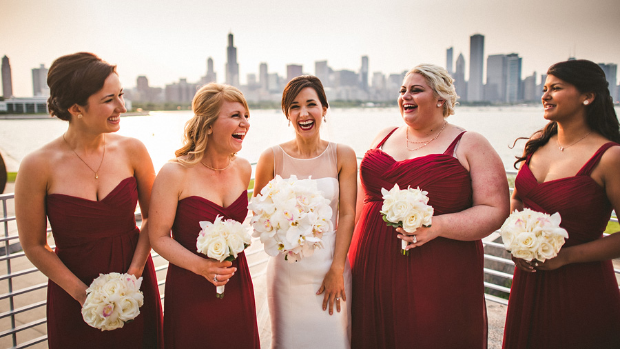 bride laughing with bridesmaids with chicago skyline