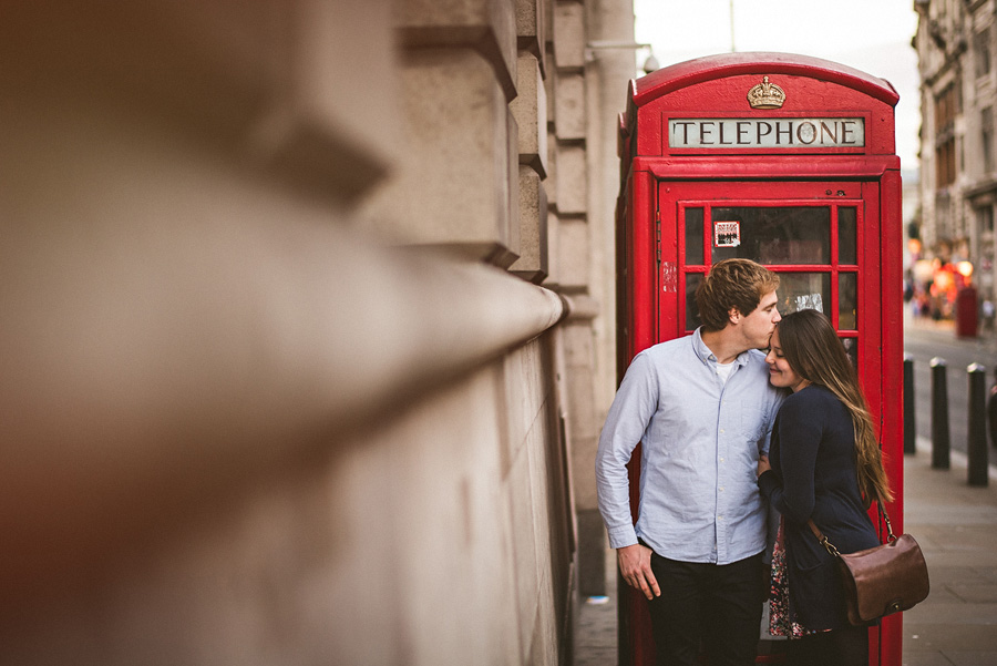 london british telephone box with engagement photos