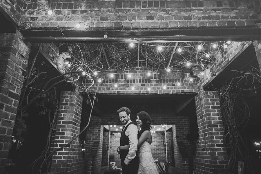 night photo of bride and groom