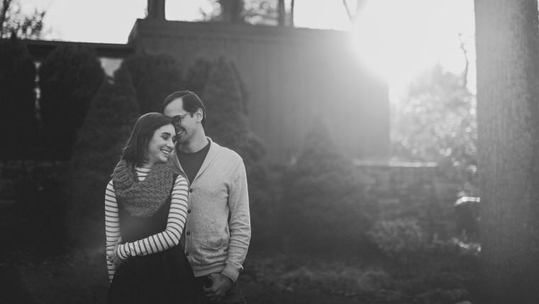 04 black and white photo of couple smiling with sun flare