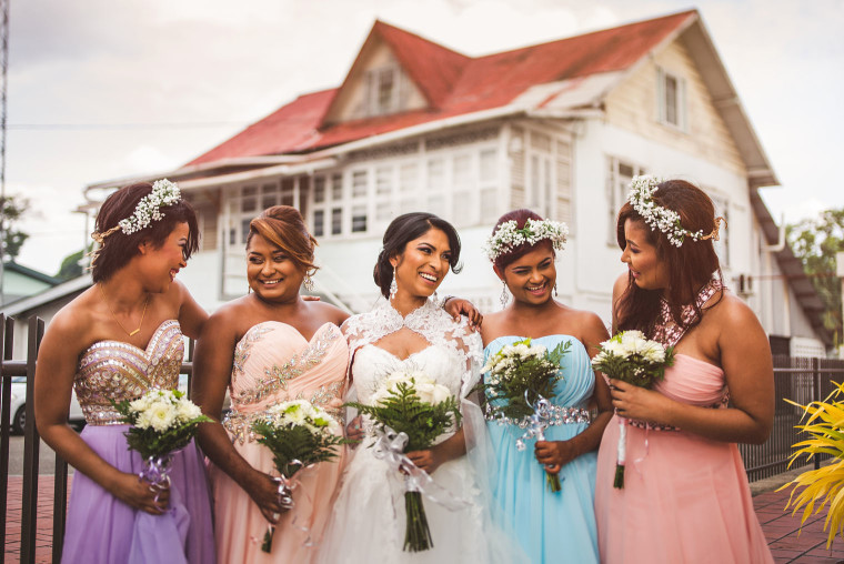 08 bride laughing with bridesmaids