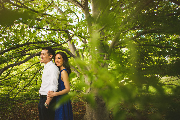 11 couple laughing under tree
