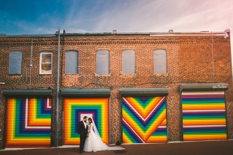 love mural in dc with wedding couple